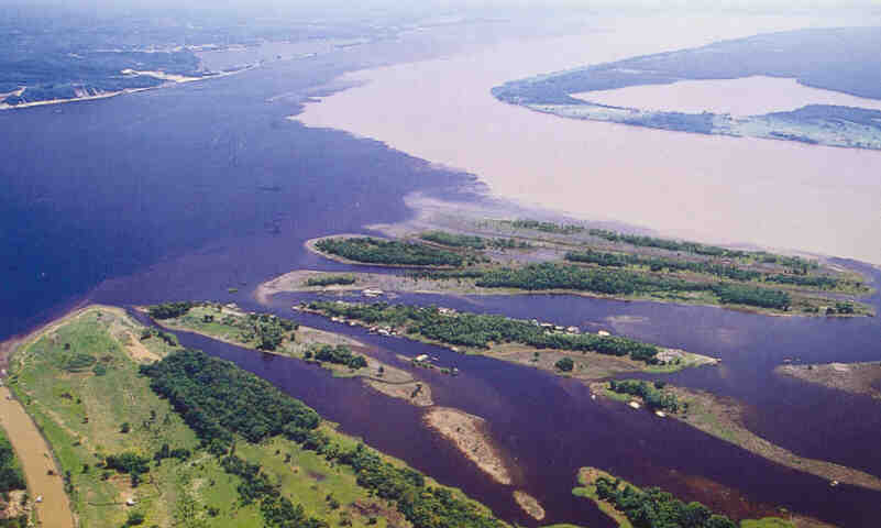 Negro (left) and Amazon (right) Rivers meet -- picture from an Amazon Cards postcard; photo copyrighted by Leonide Principe.